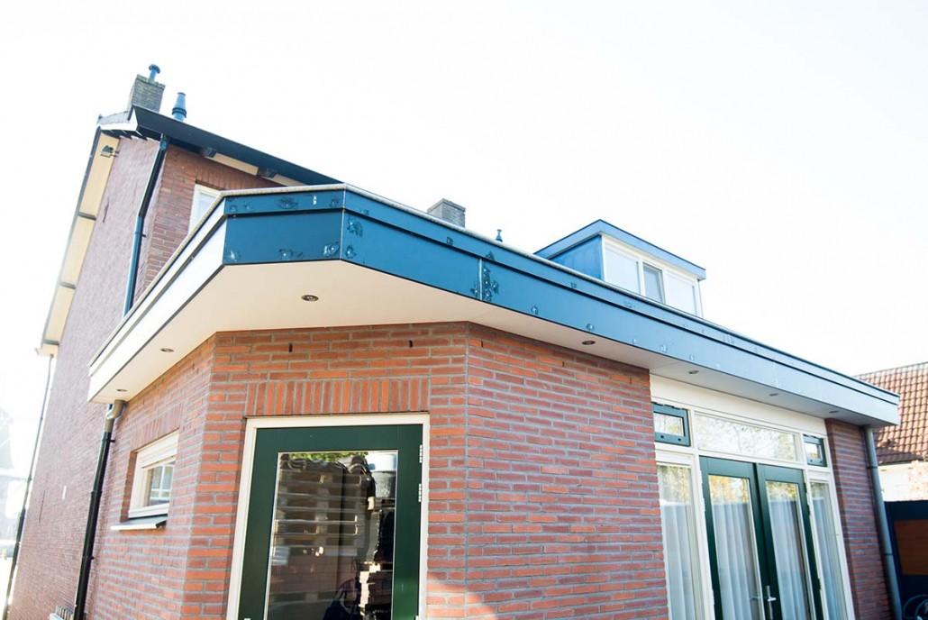 Aanbouw woning voor keuken met openslaande deuren in ede schouten